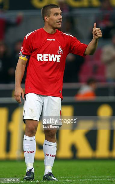 Lukas Podolski of Koeln celebrates after winning the Bundesliga match between 1 FC Koeln and FC St Pauli at RheinEnergie Stadium on September 12 2010...