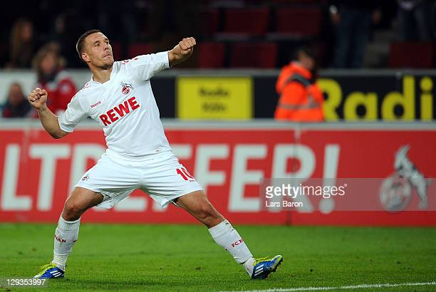 Lukas Podolski of Koeln celebrates after winning the Bundesliga match between 1. FC Koeln and Hannover 96 at RheinEnergieStadion on October 16, 2011...