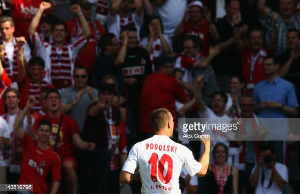 Lukas Podolski of Koeln celebrates his team's first goal during the Bundesliga match between SC Freiburg and 1 FC Koeln at Badenova Stadium on April...