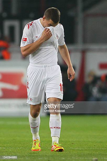 Lukas Podolski of Koeln looks dejected after the second goal of Moenchengladbach during the Bundesliga match between 1. FC Koeln and Borussia...