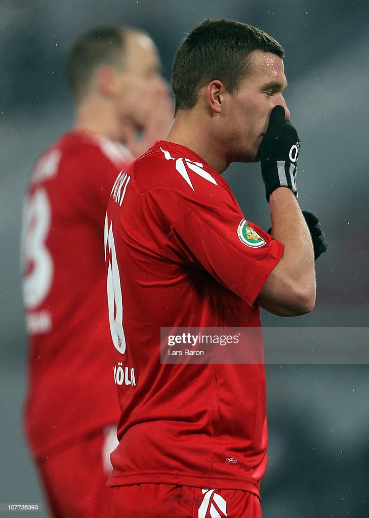 Lukas Podolski of Koeln looks dejected during the DFB Cup round of sixteen match between 1. FC Koeln and MSV Duisburg at RheinEnergie Stadium on December 22, 2010 in Cologne, Germany.