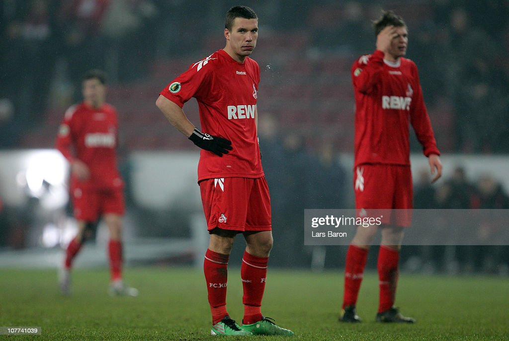 Lukas Podolski of Koeln looks dejected next to team mate Simon Trerodde after loosing the DFB Cup round of sixteen match between 1. FC Koeln and MSV Duisburg at RheinEnergie Stadium on December 22, 2010 in Cologne, Germany.