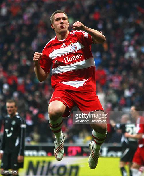 Lukas Podolski of Muenchen celebrates scoring the 5th goal during the Bundesliga match between FC Bayern Muenchen and Hannover 96 at the Allianz...