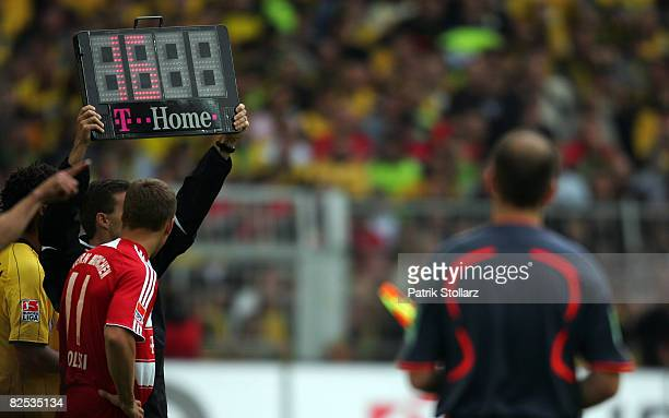Lukas Podolski of Muenchen waits for his substitution during the Bundesliga match between Borussia Dortmund and FC Bayern Muenchen at the SignalIduna...