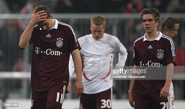 Lukas Podolski of Munich and his team mates Christian Leel and Philipp Lahm react after the UEFA Champions League Quarter Final second leg match...