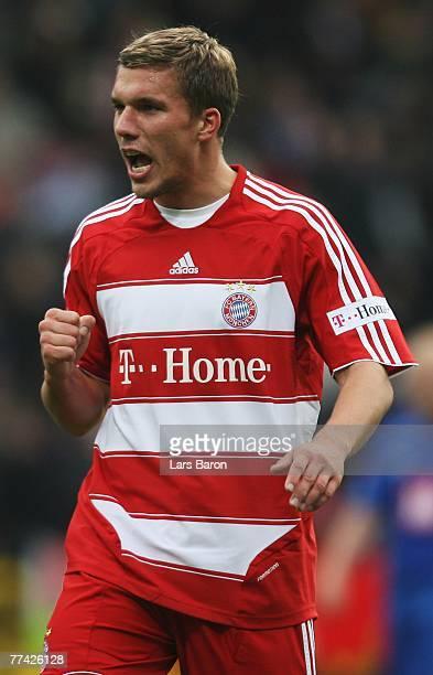 Lukas Podolski of Munich celebrates after winning the Bundesliga match between VfL Bochum and FC Bayern Munich at the rewirpower stadium on October...