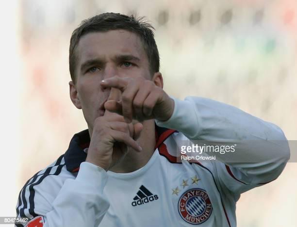 Lukas Podolski of Munich celebrates his goal against Nuernberg during the Bundesliga match between 1. FC Nuernberg and Bayern Munich at the...