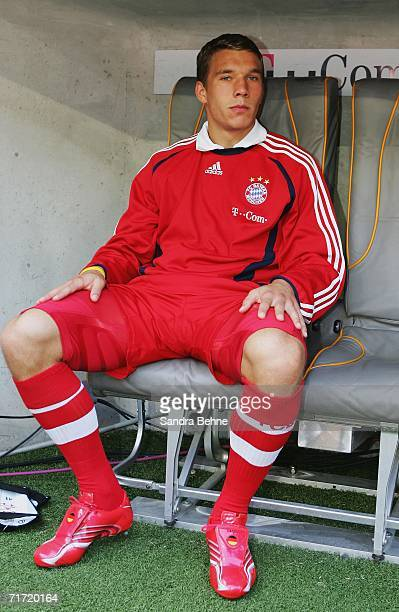 Lukas Podolski of Munich sits on the bench during the Bundesliga match between FC Bayern Munich and 1FC Nuremberg at the Allianz Arena on August 26...
