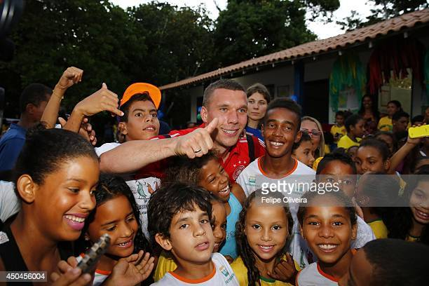 June 11: Lukas Podolski of the Germany national football team, visits the DFB Delegation at School and Kindergarten Project on June 11, 2014 in Santo...