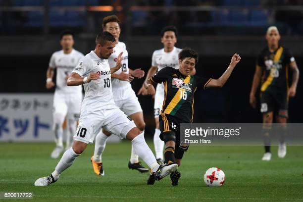 Lukas Podolski of Vissel Kobe and Hirotaka Mita of Vegalta Sendai compete for the ball during the preseason friendly match between Vegalta Sendai and...