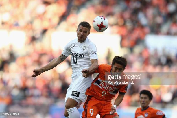 Lukas Podolski of Vissel Kobe and Ryohei Yamazaki of Albirex Niigata compete for the ball during the JLeague J1 match between Albirex Niigata and...