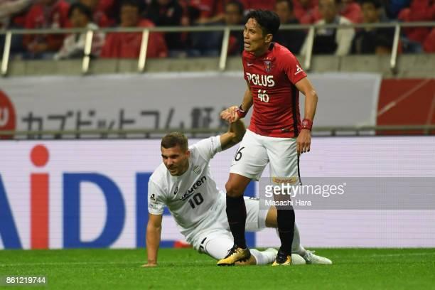 Lukas Podolski of Vissel Kobe and Ryota Moriwaki of Urawa Red Diamonds shake hands during the JLeague J1 match between Urawa Red Diamonds and Vissel...