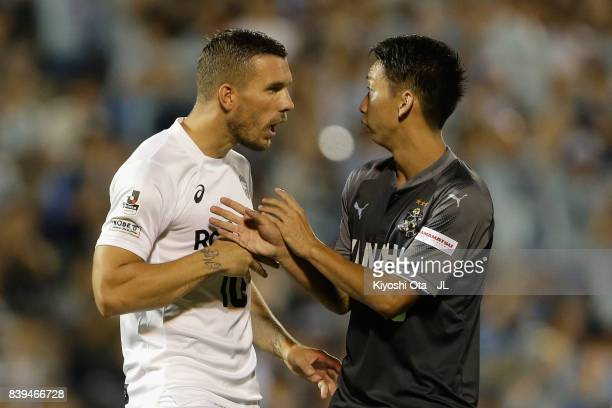 Lukas Podolski of Vissel Kobe argues with Hayao Kawabe of Jubilo Iwata after the JLeague J1 match between Jubilo Iwata and Vissel Kobe at Yamaha...