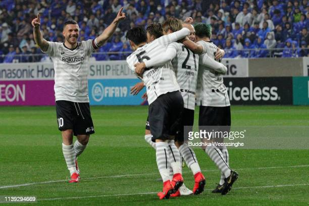 Lukas Podolski of Vissel Kobe celebrates after his team mate Junya Tanaka score a goal during the JLeague J1 match between Gamba Osaka and Vissel...