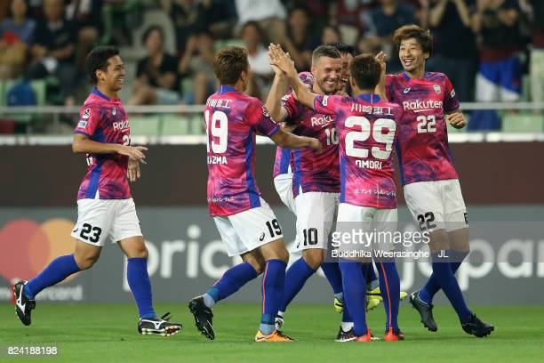 Lukas Podolski of Vissel Kobe celebrates scoring the opening goal with his team mates during the JLeague J1 match between Vissel Kobe and Omiya...