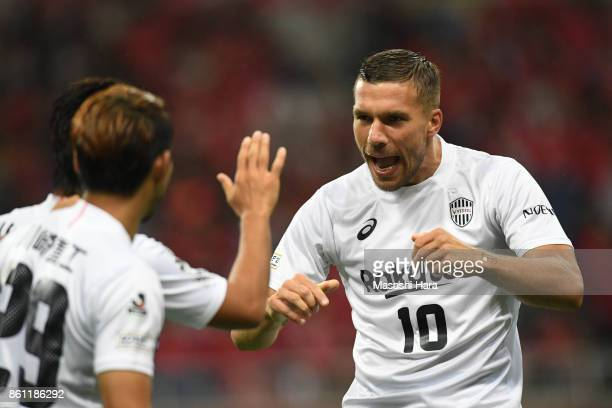 Lukas Podolski of Vissel Kobe celebrates their first goal during the JLeague J1 match between Urawa Red Diamonds and Vissel Kobe at Saitama Stadium...