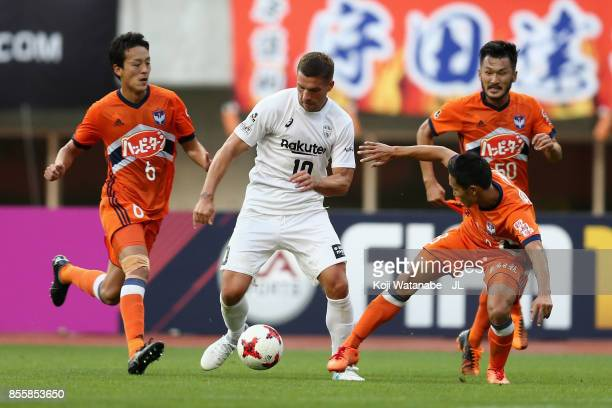 Lukas Podolski of Vissel Kobe controls the ball under pressure of Albirex Niigata defense during the JLeague J1 match between Albirex Niigata and...