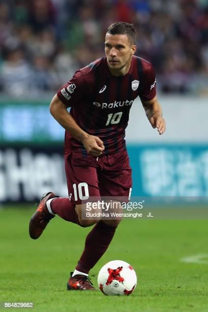 Lukas Podolski of Vissel Kobe in action during the JLeague J1 match between Vissel Kobe and Sagan Tosu at Noevir Stadium Kobe on October 21 2017 in...
