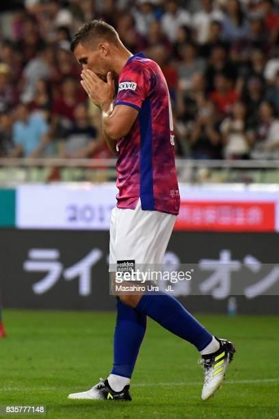 Lukas Podolski of Vissel Kobe reacts during the JLeague match between Vissel Kobe and Yokohama FMarinos at Noevir Stadium Kobe on August 20 2017 in...
