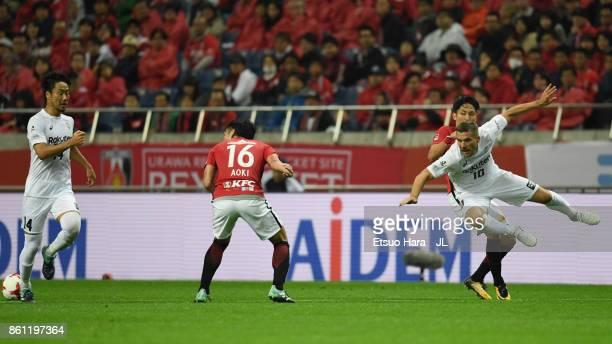 Lukas Podolski of Vissel Kobe reacts under pressure of Ryota Moriwaki of Urawa Red Diamonds during the JLeague J1 match between Urawa Red Diamonds...