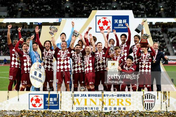 Lukas Podolski of Vissel Kobe rises up the trophy and celebrates the championship with teammates during the award ceremony of 99th Emperor's Cup...