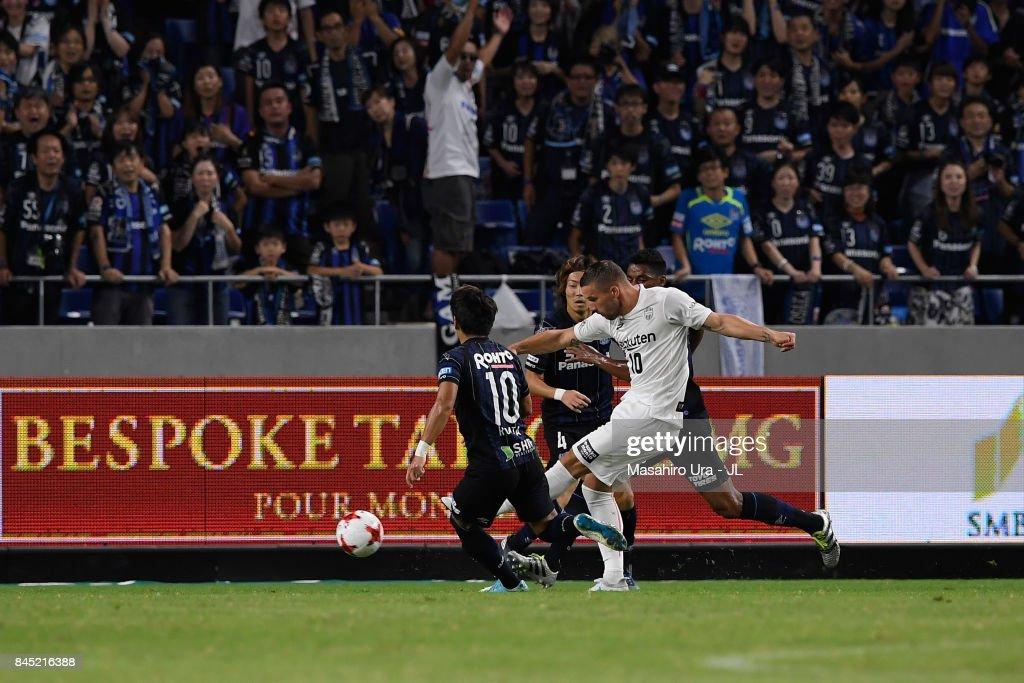 Lukas Podolski of Vissel Kobe shoots at goal during the J.League J1 match between Gamba Osaka and Vissel Kobe at Suita City Football Stadium on September 9, 2017 in Suita, Osaka, Japan.