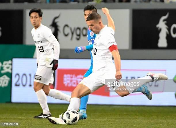 Lukas Podolski of Vissel Kobe shoots at goal during the JLeague J1 match between Sagan Tosu and Vissel Kobe at Best Amenity Stadium on February 23...
