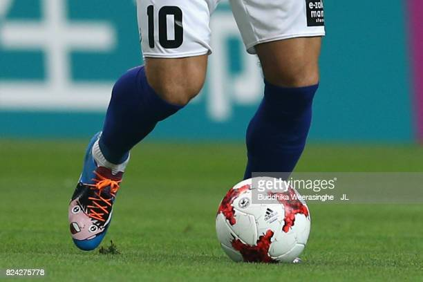 Lukas Podolski of Vissel Kobe wears boots of famous cartoon 'Captian Tsubasa' during the JLeague J1 match between Vissel Kobe and Omiya Ardija at...