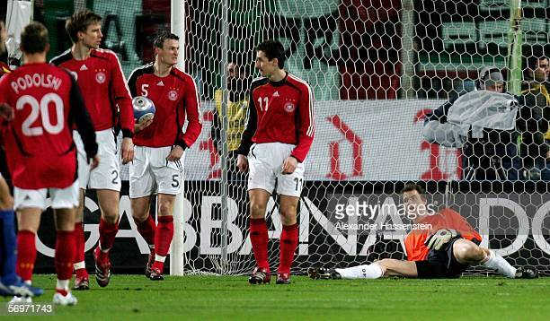 Lukas Podolski, Per Mertesacker, Robert Huth, Miroslav Klose and Jens Lehmann of Germany, look dejected after the first goal during the international...
