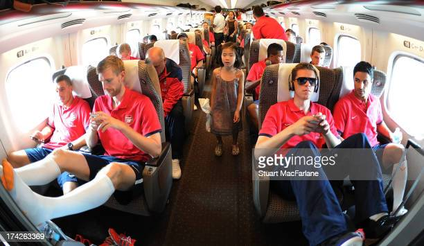 Lukas Podolski Per Mertesacker Wojciech Szczesny and Mikel Arteta of Arsenal on the Bullet train from Nagoya to Saitama in Japan for the club's...