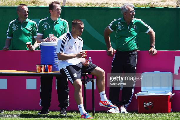 Lukas Podolski sits on a table during a Germany training session at Campo Sportivo Comunale Andrea Dora on May 12 2012 in Abbiadori Italy