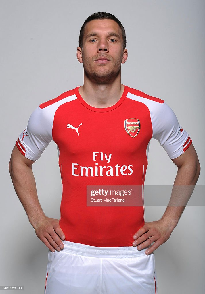 Lukas Podolski wears the new Puma Arsenal kit for season 2013/14 at London Colney on April 23, 2014 in St Albans, England.