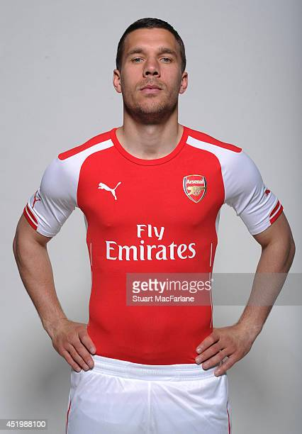Lukas Podolski wears the new Puma Arsenal kit for season 2013/14 at London Colney on April 23 2014 in St Albans England