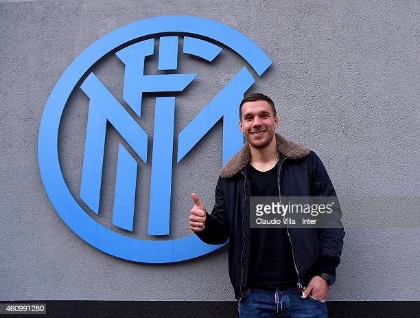 Lukas Podolski who is set to join FC Internazionale on loan until the end of the season poses for a photo in front of the club's logo at Appiano...