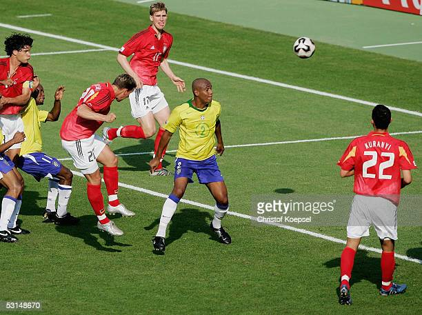 Lukas Podoslki of Germany scores the equalising goal during the semi final match between Germany and Brazil in the FIFA Confederations Cup 2005 at...