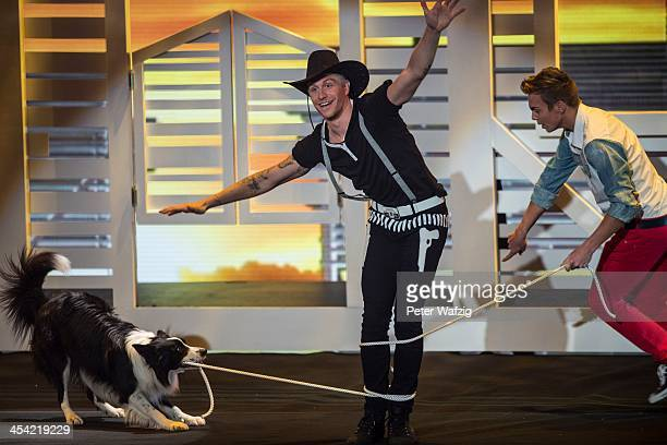 Lukas Pratschker and his dog Falco perform during the second Semifinal of 'Das Supertalent' TV Show on December 07 2013 in Cologne Germany