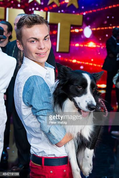 Lukas Pratschker and his dog falco posing for a photo after the second Semifinal of 'Das Supertalent' TV Show on December 07 2013 in Cologne Germany