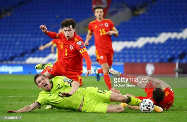 Lukas Provod of Czech Republic is challenged by Neco Williams and James Lawrence of Wales in the box during the FIFA World Cup 2022 Qatar qualifying...