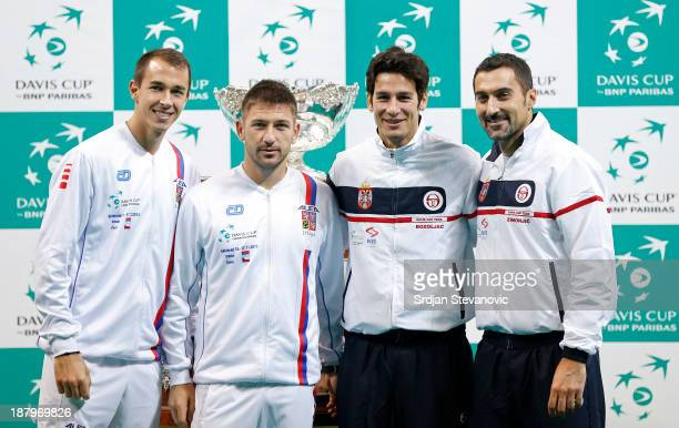 Lukas Rosol and Jan Hayek of Czech Republic pose for the photographers with Ilija Bozoljac and Nenad Zimonjic of Serbia during a draw ceremony prior...