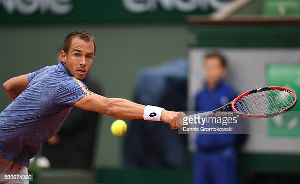Lukas Rosol of Czech Republic hits a backhand during the Men's Singles first round match against Stan Wawrinka of Switzerland on day two of the 2016...
