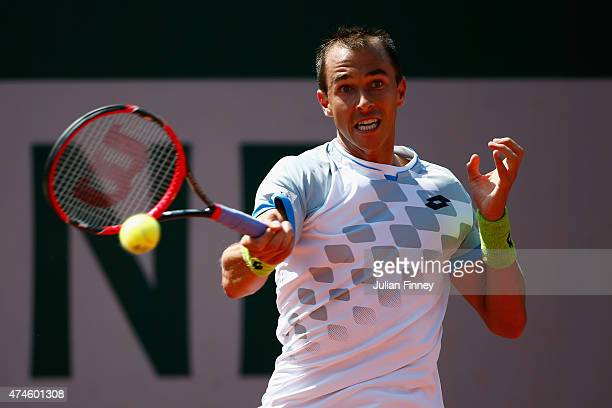 Lukas Rosol of Czech Republic plays a forehand during his Men's Singles match against Elias Ymer of Sweden on day one of the 2015 French Open at...