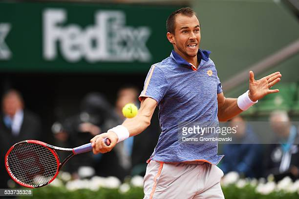 Lukas Rosol of Czech Republic plays a forehand during the Men's Singles first round match against Stan Wawrinka of Switzerland on day two of the 2016...