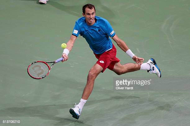 Lukas Rosol of Czech Republic plays a forehand in his match against Philipp Kohlschreiber of Germany during Day 1 of the Davis Cup World Group first...