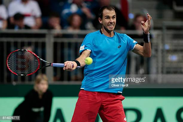 Lukas Rosol of Czech Republic plays a forehand in his match against Alexander Zverev of Germany during Day 3 of the Davis Cup World Group first round...