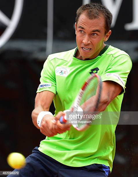 Lukas Rosol of Czech Republic returns a ball during his final match against Roberto Bautista Agut of Spain on day seven of MercedesCup at TC...