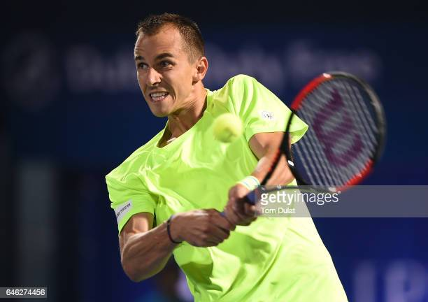 Lukas Rosol of Czech Republic returns a shot during his match against Tomas Berdych of Czech Republic on day three of the ATP Dubai Duty Free Tennis...