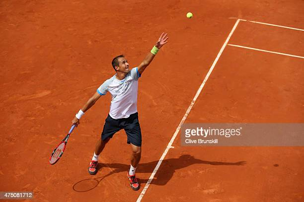 Lukas Rosol of Czech Republic serves in his Men's Singles match against Teymuraz Gabashvili of Russia on day six of the 2015 French Open at Roland...