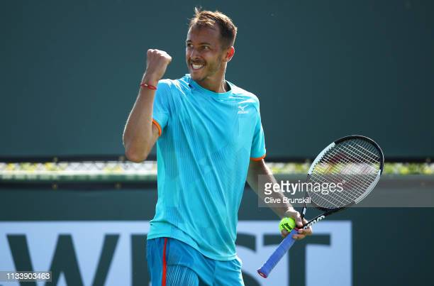 Lukas Rosol of the Czech Republic celebrates a point during his three set victory against Bernard Tomic of Australia in their second round qualifying...