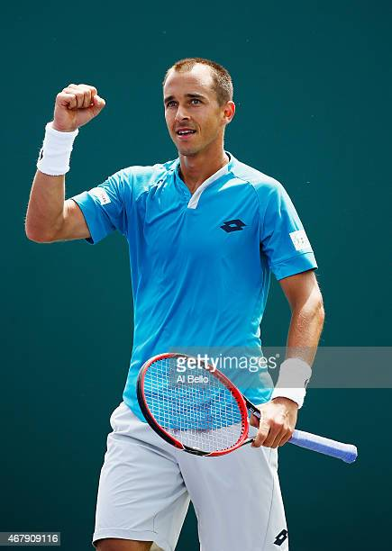 Lukas Rosol of the Czech Republic celebrates match point against Alexander Zverev of Germany during day 6 of the Miami Open at Crandon Park Tennis...