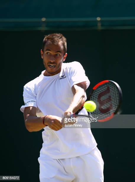 Lukas Rosol of the Czech Republic plays a backhand during the Gentlemen's Singles second round match against Gilles Muller of Luxembourg on day three...